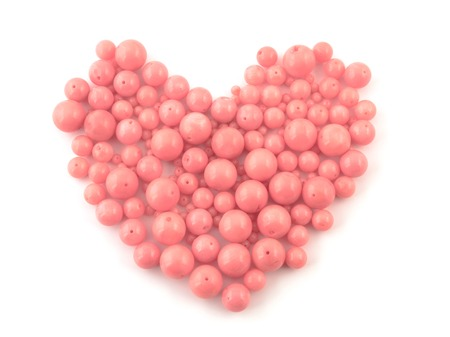 cabochon: Natural gemstone pink coral beads on a white background. Stock Photo