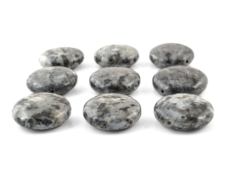 occultism: Natural mineral labradore gemstone beads isolated on white background. Stock Photo