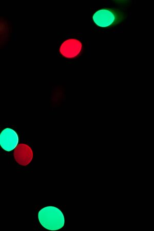 Colorful lights red and green out of focus in the dark
