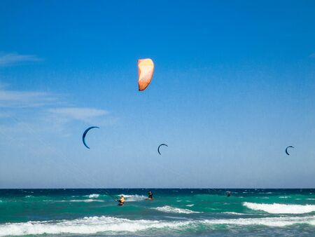 Kite surf at the beach with blue sky