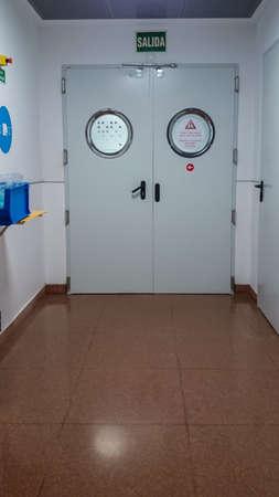 MANISES, VALENCIA/SPAIN October 7 2018 - Hospital corridor with closed doors Editorial