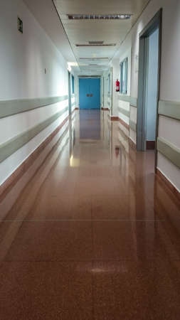 MANISES, VALENCIA/SPAIN October 7 2018 - Hospital corridor with closed and open doors Editorial