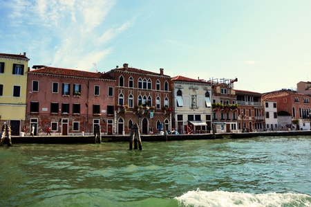 Canal Grande with typical venetian buildings construction houses, sunny day, Venice, Italy, summer 2016 Editorial