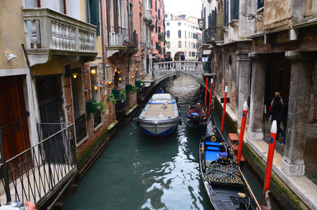 st  mark's: VENICE - February 23, 2017: Beautiful venetian canal with boats moored, Venice, Italy Editorial
