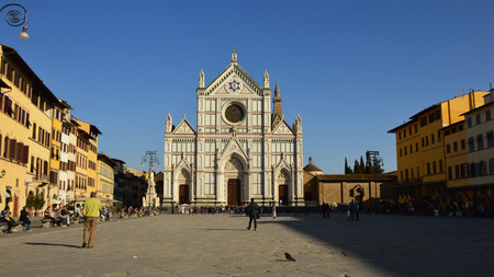 Unidentified persons visit the Basilica di Santa Croce in Piazza Santa Croce square, Florence, Italy