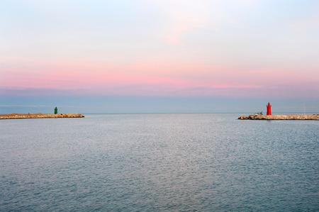 Suggestive sunset colored rose on Adriatic Sea, Trani, Apulia