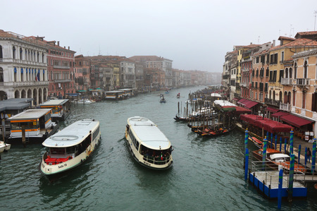 View of the Grand Canal from the Rialto Bridge in a foggy day, Venice, Italy Editorial