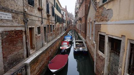 Beautiful venetian canal with boats moored, venetian scenery, Venice, Italy Editorial