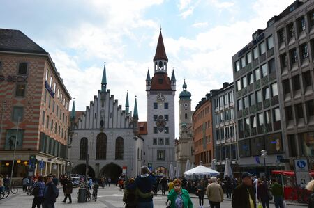 Crowd of people in the center of the old town near the Old Town Hall at Marienplatz Square, Munich, Germany