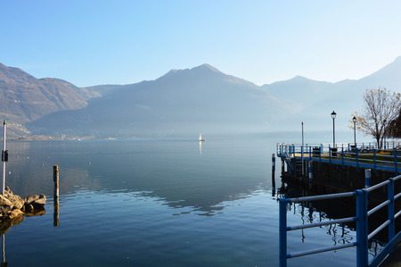 misterious: Mountain view with reflection, Lake Iseo, Lovere town, Italy