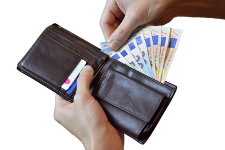 Businessmans hands holding brown leather wallet full of money - various Euros (Eur) banknotes, isolated over white background Banco de Imagens
