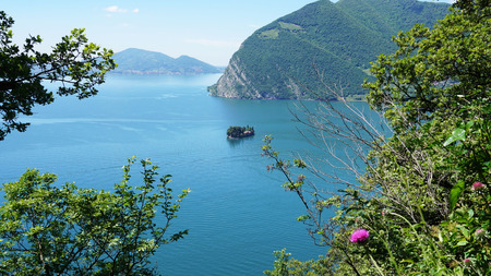 Lake panorama from Monte Isola. Italian landscape. Island on lake. View from the island Monte Isola on Lake Iseo, Italy