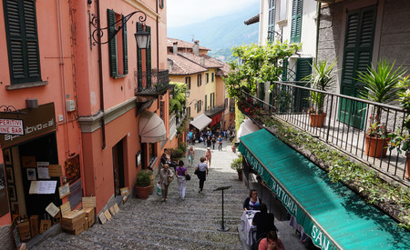 Detail of old scenic streets Salita Serbelloni in Bellagio, picturesque small town street view on Lake Como, Italy Editorial