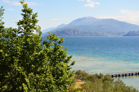Amazing view of Lake Garda from the park Parco Pubblico Tomelleri in Sirmione town, Italy