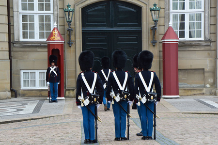 COPENHAGEN, DENMARK - MAY 31, 2017: Royal Guards during the ceremony of changing the guards at Amalienborg Castle on May 31, 2017 in Copenhagen, Denmark