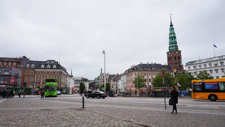 COPENHAGEN, DENMARK - MAY 31, 2017: View of Vindebrogade street and Christiansborg square with the Saint Nikolas church bells tower, Copenhagen, Denmark Editorial