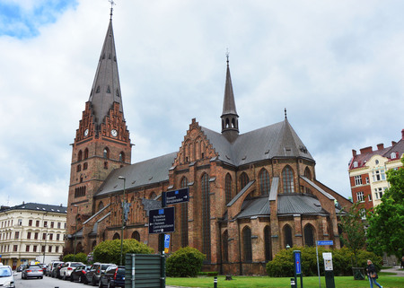MALMO, SWEDEN - MAY 31, 2017: Sankt Petri kyrka is a large church in Malmö, it is built in the Gothic style and has a 105-meter (344 ft) tall tower, Malmo, Sweden