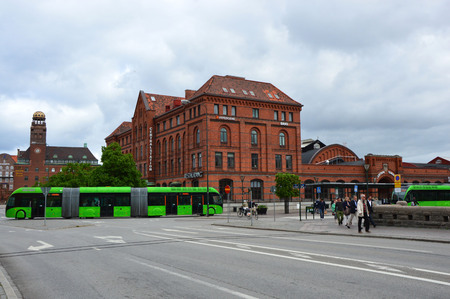 Detail of Central Station Malmo C, Central Railway Station with green articulated bus Ledbuss, Malmo, Sweden Editorial