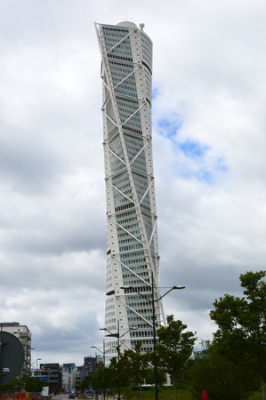 resound: MALMO, SWEDEN - MAY 31, 2017: Turning Torso designed by Santiago Calatrava is the tallest building in Scandinavia, located on Öresund strait, is considered the first twisted skyscraper in the world