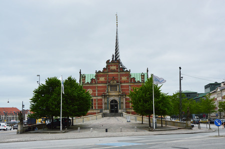 COPENHAGEN, DENMARK - MAY 31, 2017: B�rsen in B�rsgade street is 17th-century stock exchange in the center of Copenhagen. Most noted for its spire, shaped like the tails of four dragons twined together