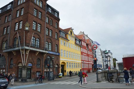 COPENHAGEN, DENMARK - MAY 31, 2017: beautiful old palaces in the famous Nyhavn promenade. Nyhavn a 17th century harbor in Copenhagen with typical colorful houses and water canals, Copenhagen, Denmark