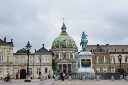 COPENHAGEN, DENMARK - MAY 31, 2017: Amalienborg Slotsplads square with a monumental equestrian statue of Amalienborgs founder, King Frederick V and Frederiks Church on the background, Copenhagen