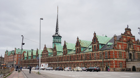 COPENHAGEN, DENMARK - MAY 31, 2017: Børsen in Børsgade street is 17th-century stock exchange in the center of Copenhagen. Most noted for its spire, shaped like the tails of four dragons twined together
