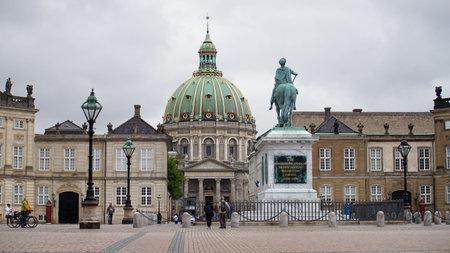 COPENHAGEN, DENMARK - MAY 31, 2017: Amalienborg Slotsplads square with a monumental equestrian statue of Amalienborg's founder, King Frederick V and Frederik's Church on the background, Copenhagen