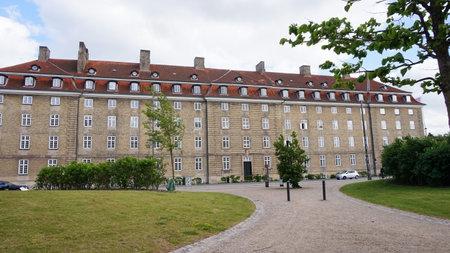 COPENHAGEN, DENMARK - MAY 31, 2017: great building in danish style with different windows for floor in Øster Voldgade street, Copenhagen, Denmark