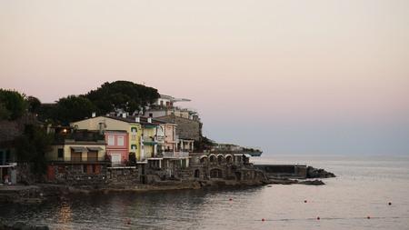 genoa: View of Rapallo beach at sunset, Liguria, Italy