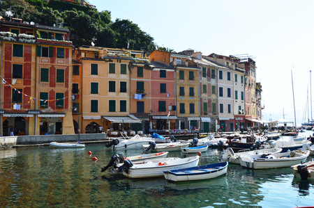 genoa: PORTOFINO, ITALY - JUNE 13, 2017: The beautiful Portofino panorama with colorful houses, luxury boats and yacht in little bay harbor. Liguria, Italy