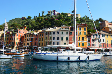 PORTOFINO, ITALY - JUNE 13, 2017: The beautiful Portofino panorama with colorful houses, luxury boats and yacht in little bay harbor. Liguria, Italy
