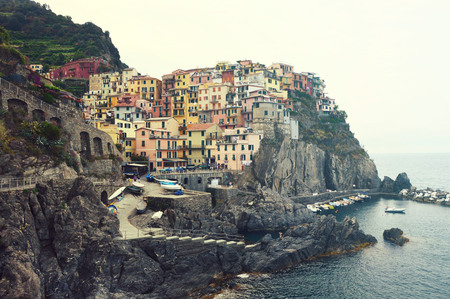 Manarola town with its colorful traditional houses on the Mediterranean Sea, Cinque Terre National Park and UNESCO World Heritage Site, Liguria, Italy