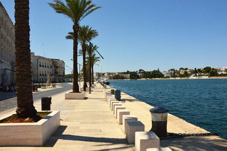 Blue water of seafront of Brindisi port, Apulia, Italy