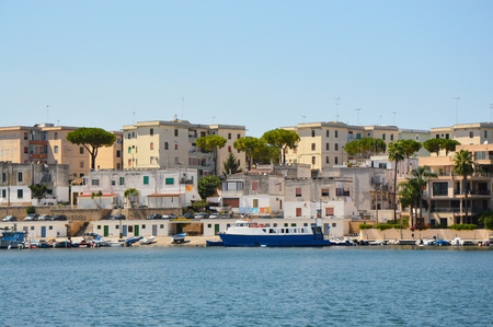 Blue water of Brindisi port with ships, Apulia, Italy Imagens