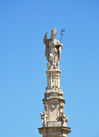 Saint Oronzo statue on baroque column in Ostuni, Apulia, Italy