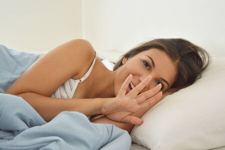 Girl in bed does not want picture Stock Photo