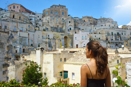South of Europe. Traveler girl looking to Matera old town, South Italy Stock Photo