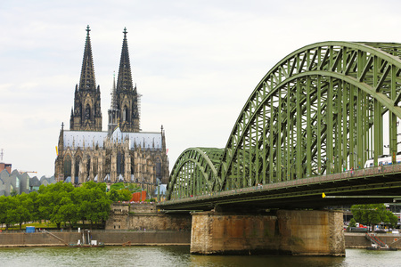 Cologne Cathedral and Hohenzollern Bridge on the Rhine River, Germany, Europe