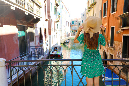 Sweet romantic girl charmed by Venice. Bridge in Venice, Italy.