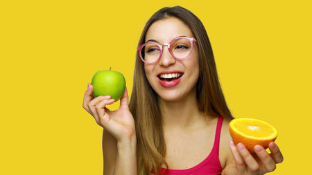 Young beautiful woman with healthy fruits