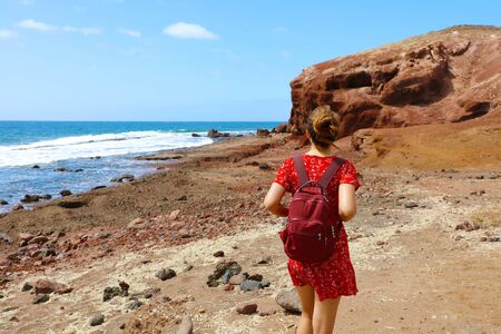 Young woman walking on El Medano in Tenerife, Canary Islands, Spain Banco de Imagens