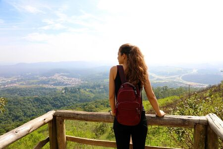Hiker with backpack enjoying view from Jaragua Peak, Sao Paulo, Brazil