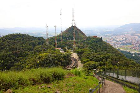 Trellis with many parables and television and radio antennas on Jaragua Peak, Sao Paulo, Brazil Stock Photo
