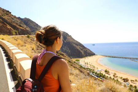 Female hiker looking to spectacular landscape of Playa de Las Teresitas, Tenerife, Canary Islands Banco de Imagens