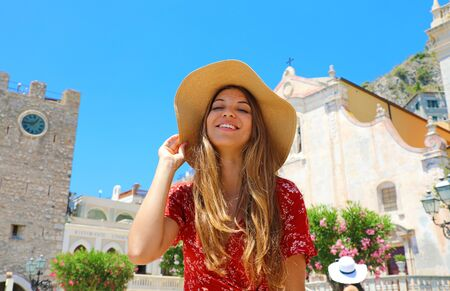 Smiling girl in main square of Taormina beautiful village on Sicily Island, Italy