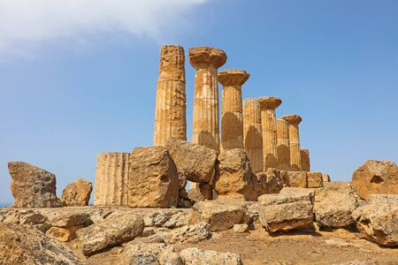 Ruined Temple of Heracles columns in famous ancient Valley of Temples of Agrigento, Sicily, Italy. Фото со стока