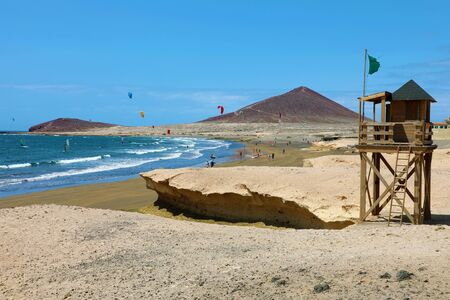 El Medano in Tenerife with Montana Roja (Red Mountain) and beach on the background