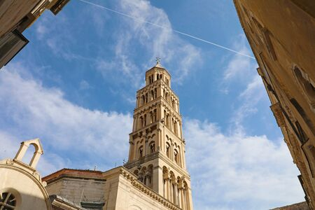 Scene from the old town of Split with the old bell tower against sky