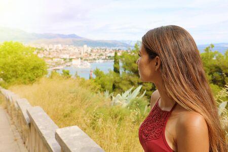 Meditative young woman looking at Split on Dalmatian Coast, Croatia, Europe